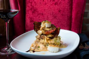 Brown Butter Cajun Lobster Tail with Spiced Crab Bisque and Seared Scallops, Sims